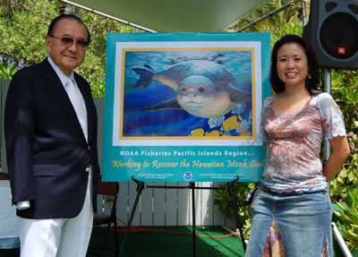 With Senator Dan Inouye at the Recovery Plan Ceremony, with the poster I illustrated for NOAA